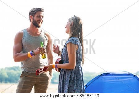 Two friends chatting in campsite on a sunny day