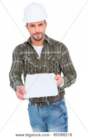 Smiling manual worker giving clipboard for signature against white background