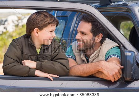 Father and son on a road trip on a sunny day