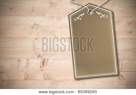 Elegant brown tag against bleached wooden planks background