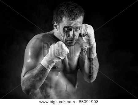 Portrait of aggressive boxer in blood