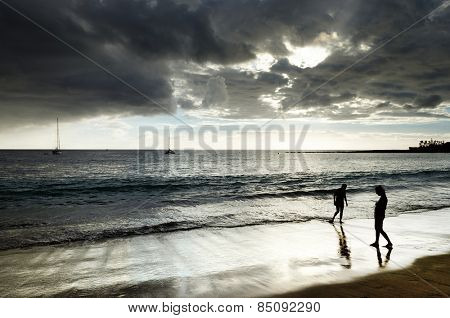Sunset walk on Playa del Ingles in Gran Canaria, Spain, Europe