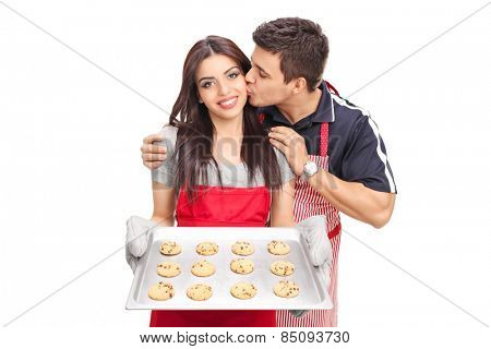 Woman baking cookies with her boyfriend isolated on white background