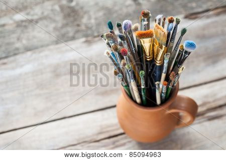 Used Painter Paintbrushes In A Jug From Potters Clay