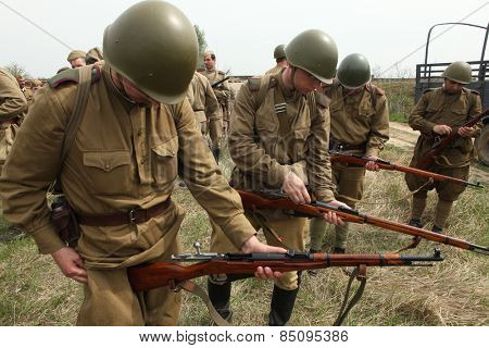 ORECHOV, CZECH REPUBLIC - APRIL 27, 2013: Re-enactors dressed as Soviet soldiers prepare to stage the Battle at Orechov (1945) near Brno, Czech Republic.