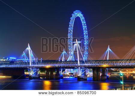 LONDON, UK - SEP 26: London Eye over Thames River on September 26, 2013 in London, UK. It is Europe's tallest Ferris wheel and the most popular paid tourist attraction in UK