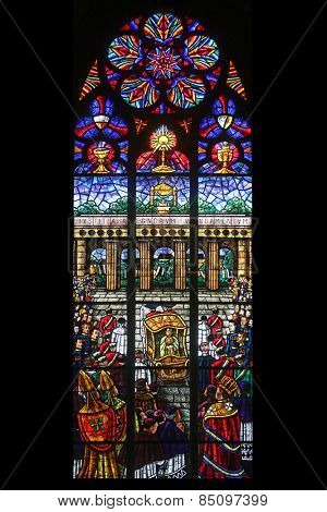 VIENNA, AUSTRIA - OCTOBER 10: Eucharistic Congress, Stained glass in Votiv Kirche (The Votive Church). It is a neo-Gothic church in Vienna, Austria on October 10, 2014