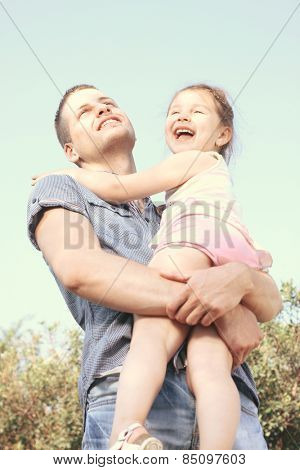 Happy little girl on uncle hug