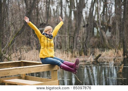 Carefree woman in the park, arms outstretched