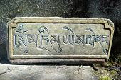 pic of nepali  - Plate with nepali word carving on the stone - JPG