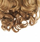 picture of strawberry blonde  - Curly hair fragment placed over the white background as a copyspace backdrop composition - JPG