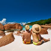 picture of couple sitting beach  - Couple sitting on a tropical beach at Seychelles - JPG