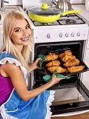 image of bap  - Young blond smilig woman bake cookies - JPG