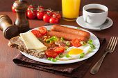 foto of bacon  - english breakfast with fried egg sausages bacon tomatoes beans - JPG