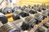 picture of racks  - Dumbells in a rack at the gym - JPG