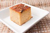 """picture of custard  - """"Mung Bean Thai Custard Dessert Recipe Khanom Maw Kaeng""""(thai name) made with eggs and pumpkin Ancient thai dessert in white bowl on fabric - JPG"""