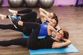 Постер, плакат: Girls perform exercises for abdominal muscles