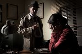 image of cry  - Desperate woman crying head in hands and confident detective standing in his office - JPG