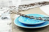 image of pussy-willows  - Easter table setting with pussy willow branches on color wooden background - JPG