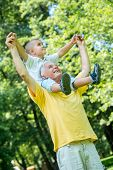 image of grandfather  - happy grandfather and child have fun and play in park on beautiful  sunny day - JPG