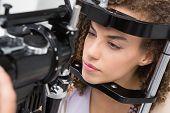 pic of slit  - Woman doing eye test in medical office - JPG
