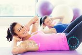 picture of pilates  - Two fit young women doing pilate exercises against fitness interface - JPG