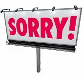 stock photo of forgiven  - Sorry word in red letters on an outdoor billboard or sign asking for forgiveness in a public message of apology - JPG