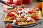 picture of maple syrup  - Homemade waffles with maple syrup and strawberries topped cream and chocolate chips orange fresh beverage - JPG