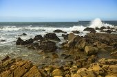 stock photo of atlantic ocean  - Surf at rocky ocean coast - JPG
