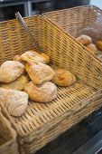 pic of tong  - Baskets with delicious breads and tongs at the bakery - JPG