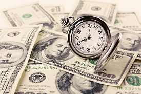 pic of money  - Silver pocket clock and money close - JPG