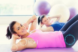 pic of pilates  - Two fit young women doing pilate exercises against fitness interface - JPG