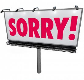 picture of forgiveness  - Sorry word in red letters on an outdoor billboard or sign asking for forgiveness in a public message of apology - JPG
