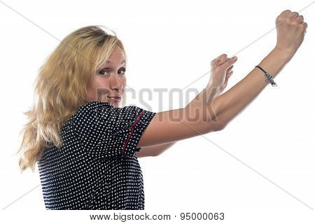 Image of woman with blond hair, hands up