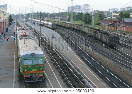 Railway Station. Trains, Platform, Wagons, People. An Empty Freight Train. The View From The top
