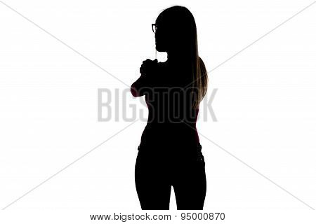 Silhouette of slim woman looking from back