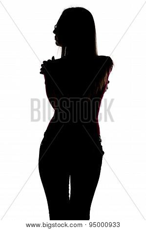 Silhouette of slim hugging woman from back