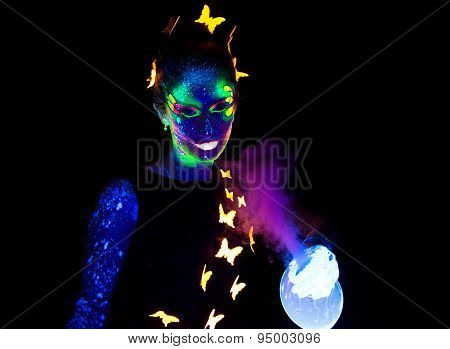 Photo of woman holding luminous steaming bubble