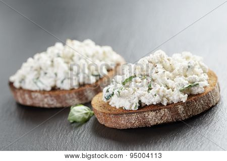 rye sandwiches or bruschetta with ricotta cheese and herbs
