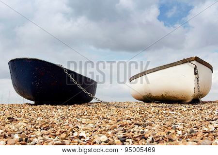 Two row boats on the foreshore