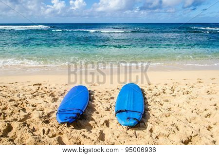 Two Surfboards On The Sandy Beach In Hawaii