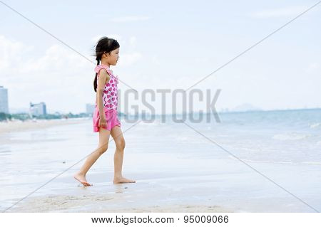 Little Asian Girl Walk On The Beach