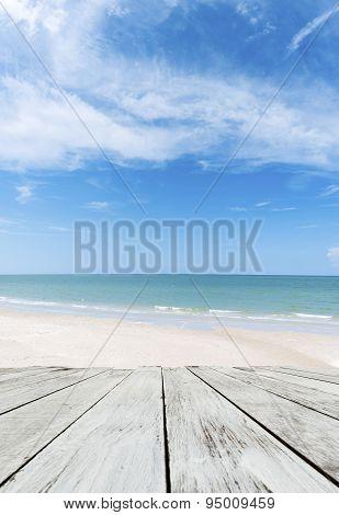 Wood Table On The Beach
