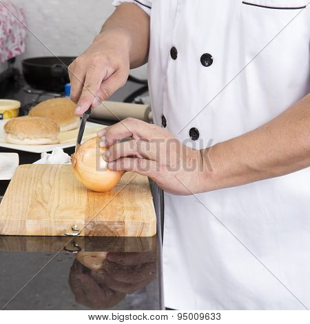 Chef Cutting Onion For Making Hamburger