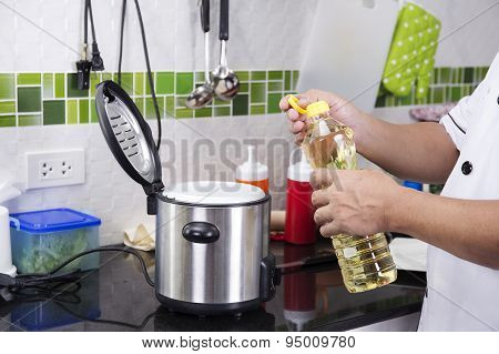 Chef Open Cap Of Vegetable Oil