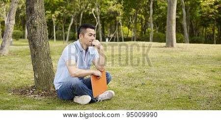Asian Man Thinking Outdoors