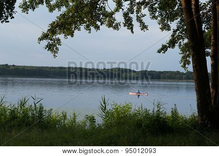Paddler On The Lake