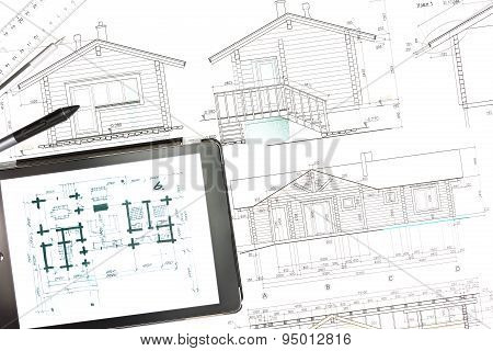 House Plan Blueprints With Tablet Computer
