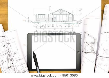 Workplace With Digital Tablet, Plans And Rolls