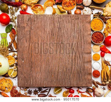 Spices And Herbs On Brown Background.